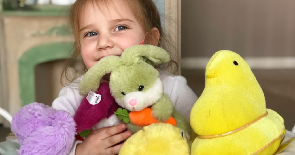 child playing with stuffed animals