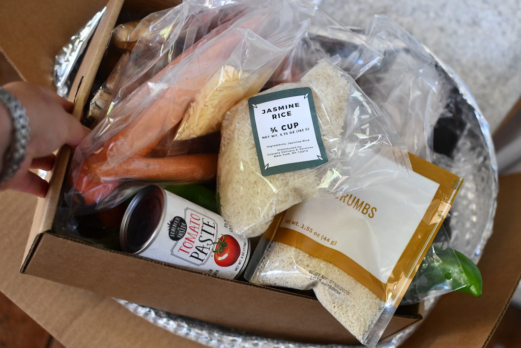 meal delivery box filled with grocery ingredients