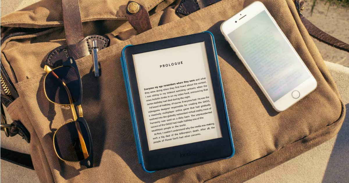 kindles sitting on towel with sunglasses
