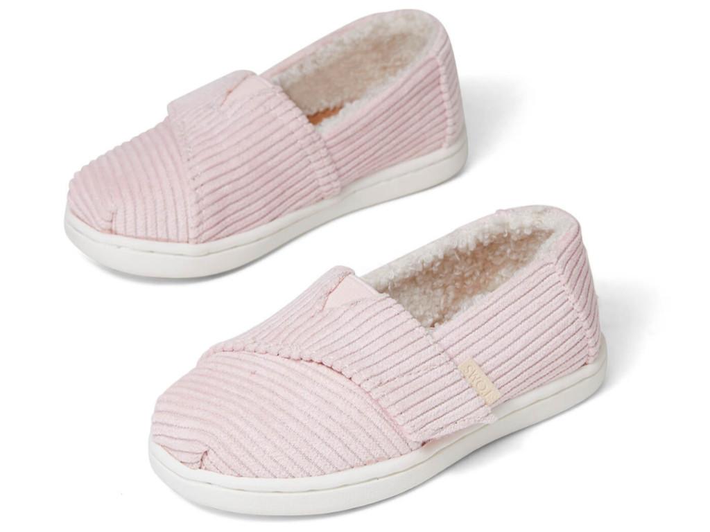 pair of TOMS pink baby ballet slip ons