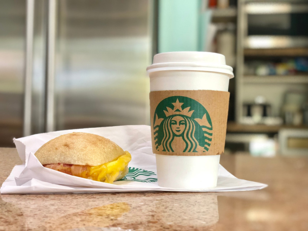 Starbucks drink and breakfast sandwich on counter