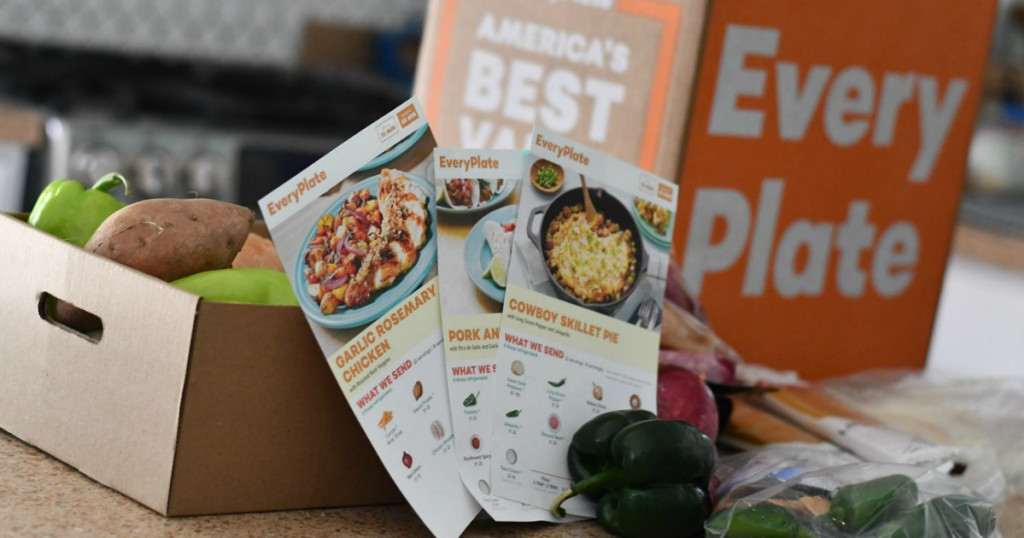 EveryPlate box with produce and recipe cards